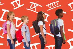 Composite image of school kids standing in school corridor. School kids standing in school corridor against red background Stock Photos