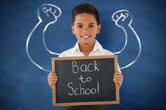 Composite image of schoolboy holding slate with text over white background Royalty Free Stock Photo