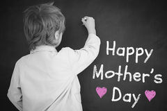 Composite image of schoolchild with blackboard. Schoolchild with blackboard against mothers day greeting Stock Image