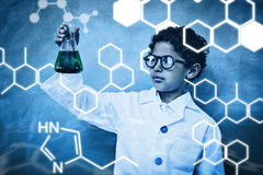 Composite image of science graphic. Science graphic against bboy holding conical flask in classroom Royalty Free Stock Images