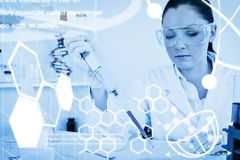 Composite image of science graphic. Science graphic against beautiful redhaired scientist using a pipette Stock Photography