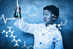 Composite image of science graphic. Science graphic against boy holding conical flask in classroom Royalty Free Stock Photos
