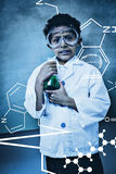 Composite image of science graphic. Science graphic against boy holding conical flask in classroom Stock Photography