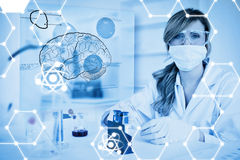 Composite image of science graphic. Science graphic against chemist working in protective suit with futuristic interface showing a brain Stock Photography