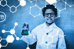 Composite image of science graphic. Science graphic against cute boy holding conical flask in classroom Royalty Free Stock Images