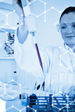 Composite image of science graphic. Science graphic against cute female biologist holding a manual pipette with sample from test tubes Stock Photography