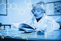 Composite image of science graphic. Science graphic against cute pupil dressed up as scientist in classroom Stock Photos