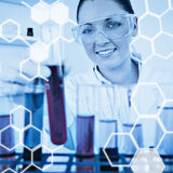 Composite image of science graphic. Science graphic against gorgeous redhaired female holding a test tube Stock Photos