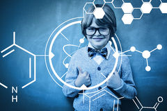 Composite image of science graphic. Science graphic against little boy gesturing thumbs up against blackboard Royalty Free Stock Image