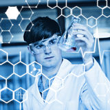 Composite image of science graphic. Science graphic against scientist looking at a liquid in an erlenmeyer flask Stock Photography