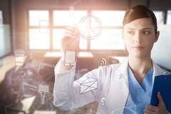 Composite image of scientist writing on glass wall royalty free stock image