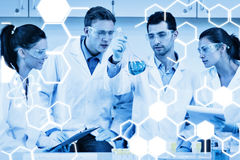 Composite image of scientists working on an experiment at the laboratory. Scientists working on an experiment at the laboratory against science graphic royalty free illustration