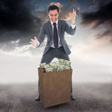 Composite image of screaming businessman catching Royalty Free Stock Images