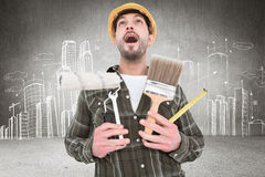 Composite image of screaming manual worker holding various tools Stock Photography