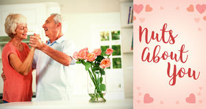 Composite image of senior couple dancing and valentines words. Composite image of senior couple dancing against backgrounds working Royalty Free Stock Image