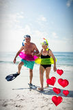 Composite image of senior couple and floating love hearts 3d Stock Photo