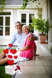 Composite image of senior couple and hearts flying from box 3d Royalty Free Stock Photography