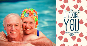 Composite image of senior couple in pool and valentines words. Valentines words against portrait of happy mature couple in swimming pool Royalty Free Stock Photos