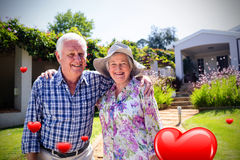 Composite image of senior couple and valentines hearts 3d Royalty Free Stock Image