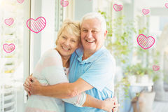 Composite image of senior couple and valentines hearts 3d Stock Photos