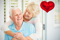 Composite image of senior couple and valentines hearts 3d Stock Photo