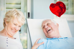 Composite image of senior couple and valentines hearts 3d Stock Photography