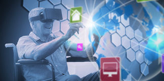 Composite image of senior man holding virtual glasses sitting on his wheelchair Stock Photography