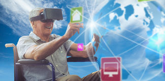 Composite image of senior man holding virtual glasses sitting on his wheelchair Royalty Free Stock Photo