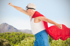 Composite image of senior man wearing superman costume Royalty Free Stock Images