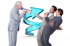 Composite image of senior salesman with megaphone yelling at his employees. Senior salesman with megaphone yelling at his employees against blue spiral arrow Royalty Free Stock Photo