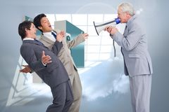 Composite image of senior salesman with megaphone yelling at his employees. Senior salesman with megaphone yelling at his employees against room with holographic Royalty Free Stock Photography