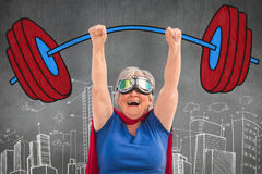 Composite image of senior woman pretending to be a superhero Royalty Free Stock Photography