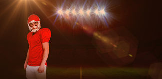 Composite image of serious american football player wearing a helmet Stock Images