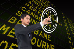 Composite image of serious asian businessman pointing Stock Photography