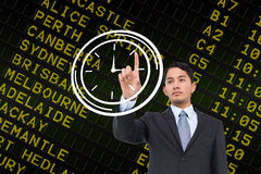 Composite image of serious asian businessman pointing Stock Image