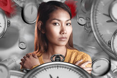 Composite image of serious asian woman with hands on shoulders Stock Photography