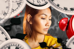 Composite image of serious asian woman looking down Royalty Free Stock Images