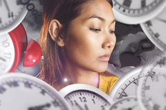 Composite image of serious asian woman looking down Stock Image