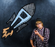 Composite image of serious blond hipster smoking a pipe Royalty Free Stock Images