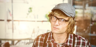 Composite image of serious blond hipster staring Stock Photos