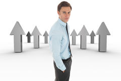 Composite image of serious businessman with hand in pocket Royalty Free Stock Photos