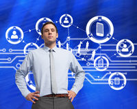 Composite image of serious businessman with hands on hips Royalty Free Stock Photography
