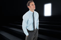 Composite image of serious businessman with hands in pockets Royalty Free Stock Images