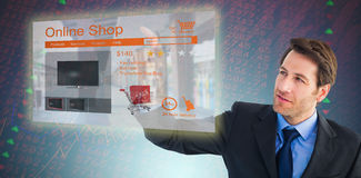 Composite image of serious businessman pointing at something royalty free stock images