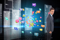 Composite image of serious businessman standing Stock Image