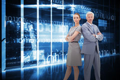 Composite image of serious businessman standing back-to-back with a woman Royalty Free Stock Photos