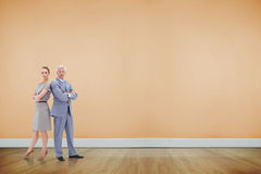 Composite image of serious businessman standing back to back with a woman Royalty Free Stock Images