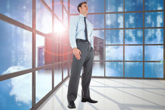 Composite image of serious businessman standing with hand in pocket Royalty Free Stock Photography