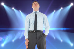 Composite image of serious businessman standing with hand in pocket Royalty Free Stock Photos