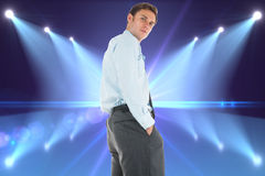 Composite image of serious businessman standing with hands in pockets Royalty Free Stock Images